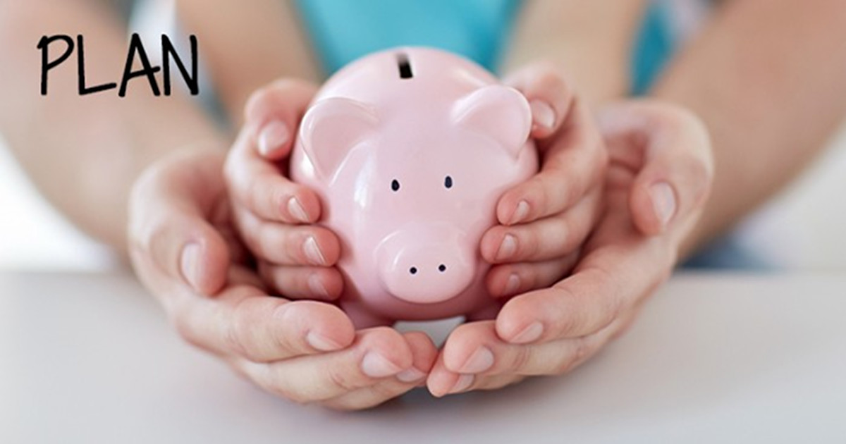family, children, money, investments and people concept - close up of father and daughter hands holding pink piggy bank